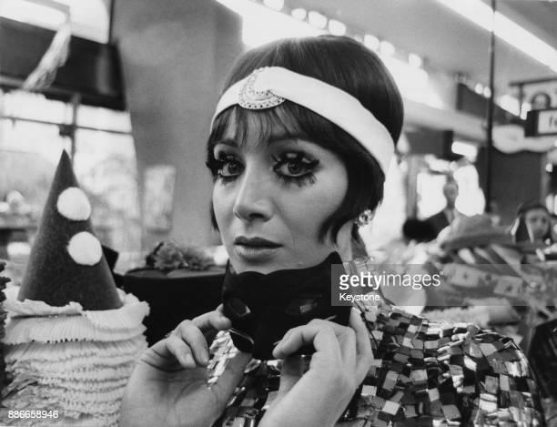 Italian actress Maria Grazia Buccella films a supermarket scene for the film 'Dove vai tutta nuda' Italy 19th January 1969