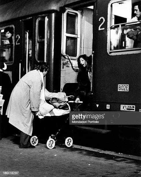 Italian actress Mariangela Melato helping Swedishborn Italian actor Lou Castel trying to catch a pushchair from a train carriage in the film Caro...