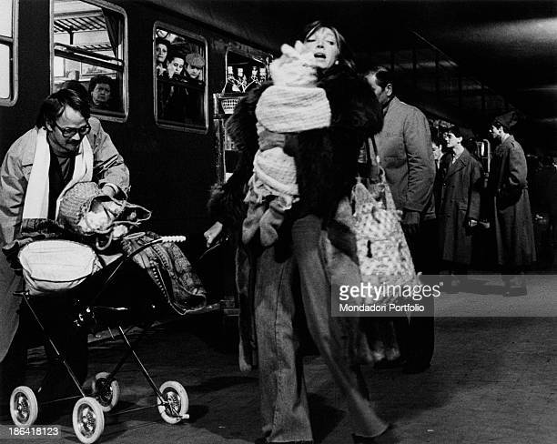 Italian actress Mariangela Melato just got off a train holding a baby while Swedishborn Italian actor Lou Castel pushing a pushchair in the film Caro...