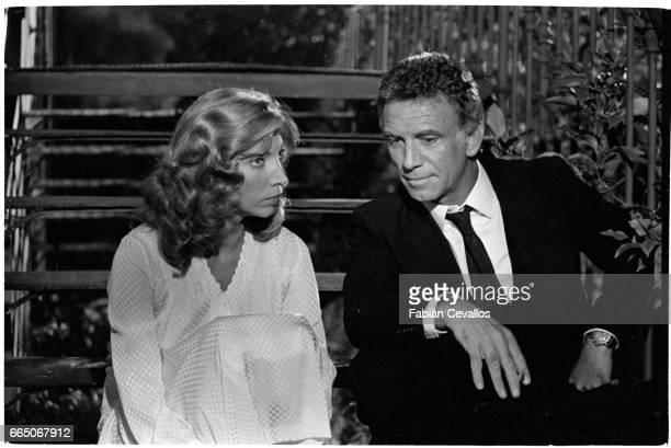 Italian actress Mariangela Melato sits next to American actor Tony Franciosa on the set of the 1981 movie Aiutami a Sognare The Italian film called...