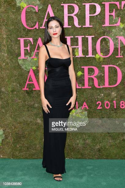 Italian actress Marica Pellegrinelli poses as she arrives to attend the Green Carpet Fashion Awards 2018 within the Women's Spring/Summer 2019...