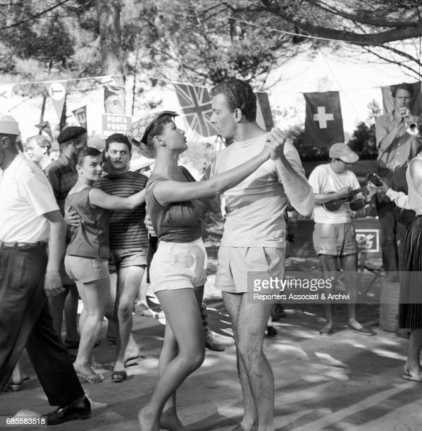 Italian actress Marisa Allasio dancing with Italian actor Paolo Ferrari in a scene from the film Camping Italy 1957
