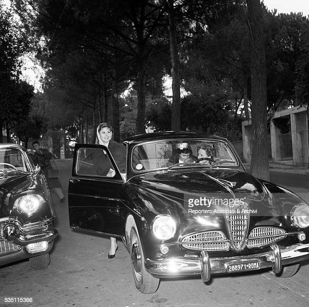 Italian actress Marisa Allasio getting on a car with her mother Lucia and her sister Fiorella 1955
