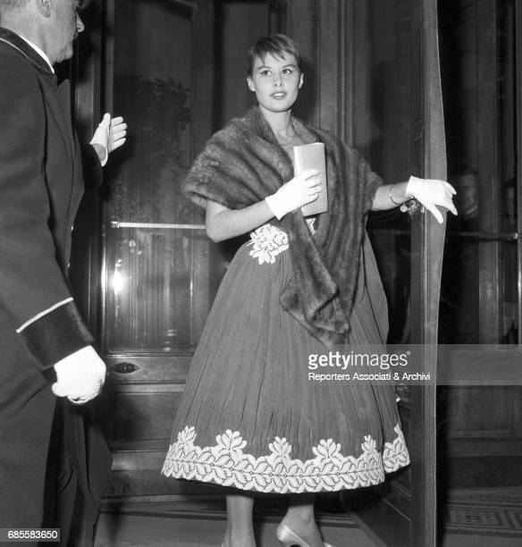 Italian actress Marisa Allasio in and evening gown and a fur at a cocktail organized for the prize ceremony for the III Cinema Rally Italy 1956