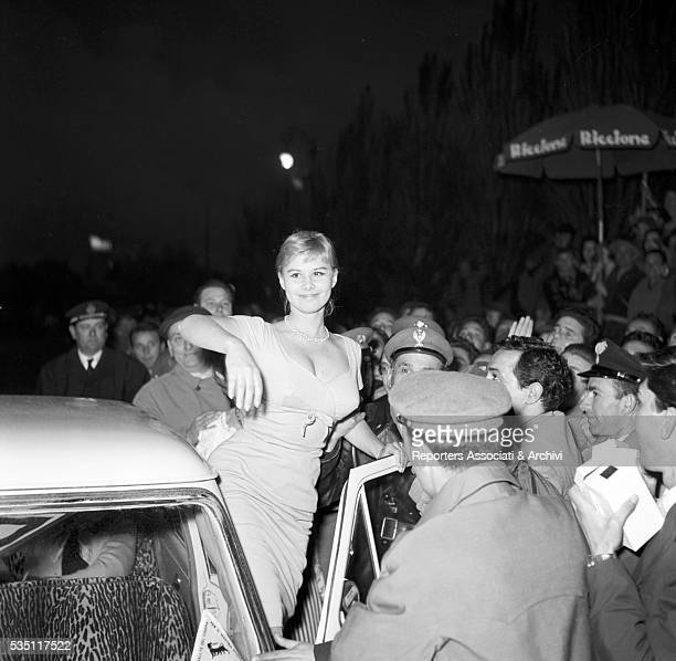 Italian actress Marisa Allasio surrounded by curious people at the 4th Cinema Rally Italy April 1957