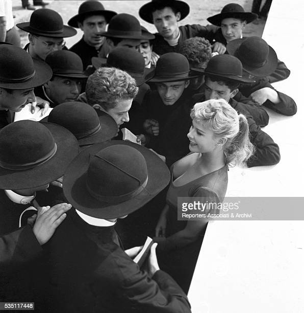 Italian actress Marisa Allasio surrounded by young priests 1957