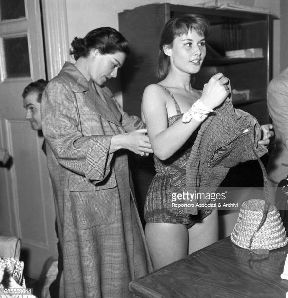Italian actress Marisa Allasio trying a swimsuit on before attending to the III Cinema Rally Italy 1956