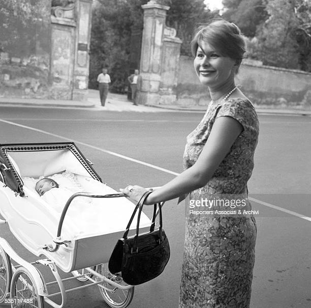 Italian actress Marisa Allasio walking with her son Carlo Giorgio Calvi in the pram 1st August 1959