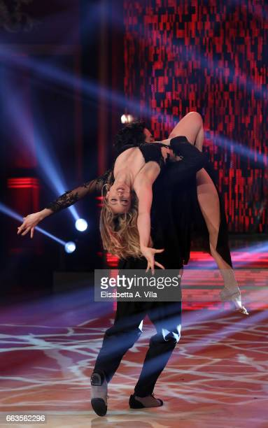 Italian actress Martina Stella and her dance partner Samuel Peron perform on the Italian TV show 'Ballando Con Le Stelle' at Auditorium Rai on April...