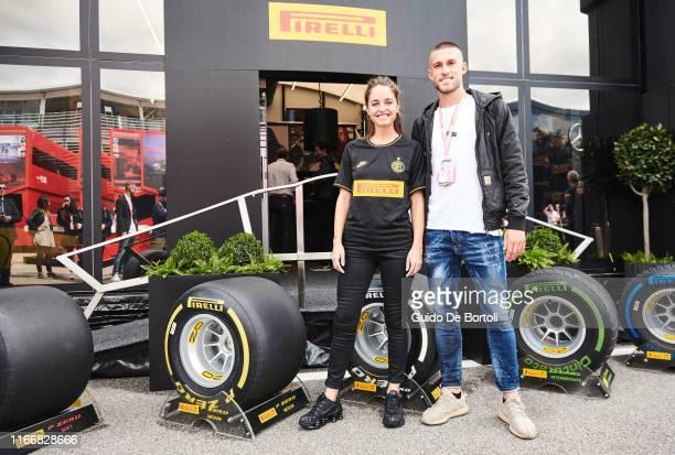 Italian actress Matilde Gioli and football player Cristiano Biraghi are seen on race day of the Formula 1 Italian Grand Prix at Autodromo di Monza on...