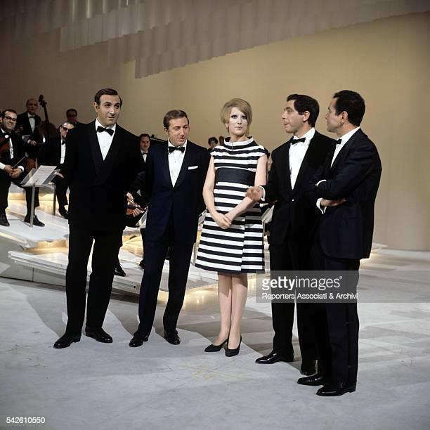 Italian actress Mina Italian TV hosts Pippo Baudo Corrado and Enzo Tortora and AmericanItalian TV host Mike Bongiorno in the TV show Sabato sera 1967