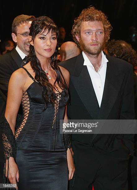 Italian actress Monica Bellucci and French actor Vincent Cassel arrive at the Festival Palace to attend the screening of the film 'Irreversible'...