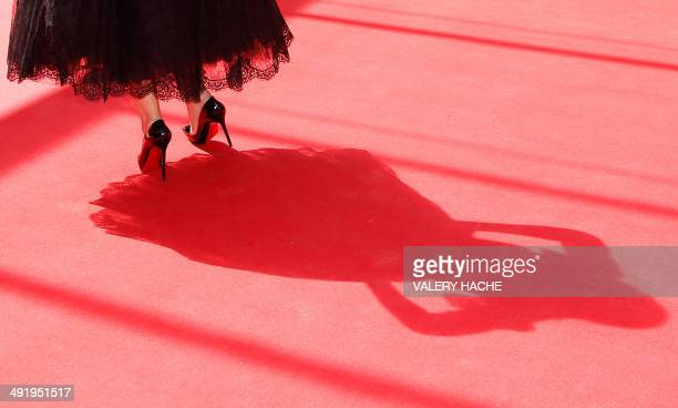 Italian actress Monica Bellucci poses as she arrives for the screening of the film 'Le Meraviglie ' at the 67th edition of the Cannes Film Festival...