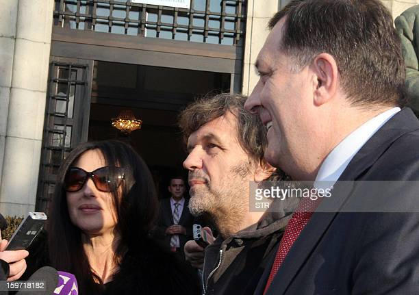 Italian actress Monica Belluci and Bosnian born film director Emir Kusturica address media as they are greeted by Milorad Dodik prior to a meeting...