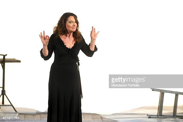 Italian actress Monica Guerritore gesticulates quizzically addressing a conspiratorial gaze to the camera at the end of the show You Ask Me to Speak...