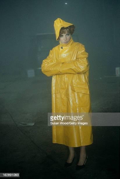 Italian actress Monica Vitti dressed in a raincoat in a scene from the film 'Modesty Blaise' 1965