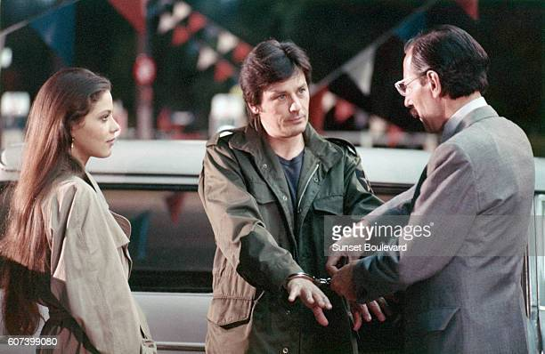 Italian actress Ornella Muti and French actors Alain Delon and Jean Bouise on the set of Mort d'un Pourri directed by Georges Lautner