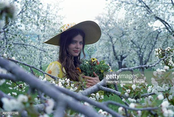 Italian actress Ornella Muti wearing a flowered dress in the film Come Home and Meet My Wife Italy 1974