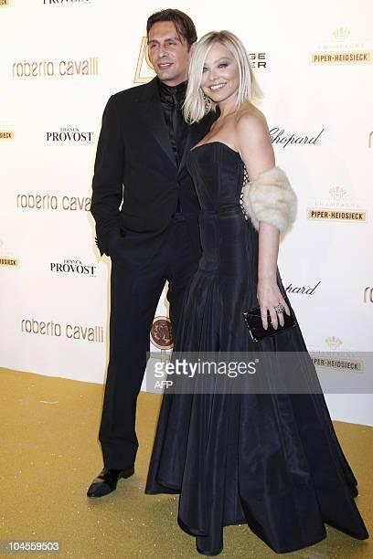 Italian actress Ornella Mutti and his companion Fabrice Kerherve pose prior to a diner organized to celebrate Italian fashion brand Roberto Cavalli...