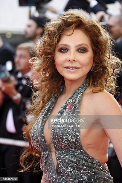 Italian actress Ornella Mutti poses as she arrives to attend the opening ceremony and the screening of Brazilian director Fernando Meirelles' film...