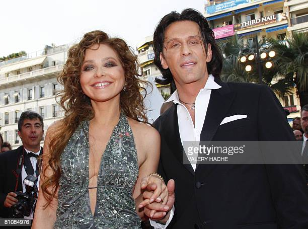 Italian actress Ornella Mutti poses with her partner as she arrives to attend the opening ceremony and the screening of Brazilian director Fernando...