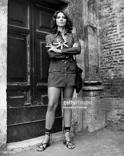 Italian actress Paola Pitagora posing with folded arms and a cigar between her fingers The actress wears a necklace made of fangs Rome 1970s