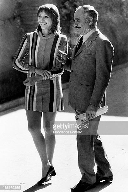 Italian actress Paola Pitagora smiling on the film set of The True and the False Beside her American actor Martin Balsam smoking a cigarette Rome 1972