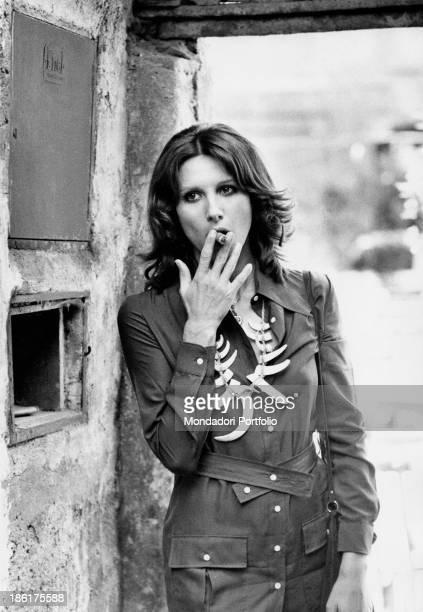 Italian actress Paola Pitagora smoking a cigar The actress wears a necklace made of fangs Rome 1970s