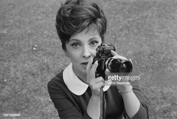 Italian actress photojournalist and sculptor Gina Lollobrigida holding a Pentax camera UK 13th August 1963