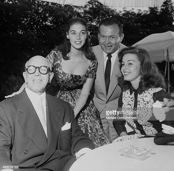 Italian actress Pier Angeli poses with Jimmy McHugh Johnny Grant and actress Elaine Stewart during Jimmy McHugh's garden party in Los Angeles...