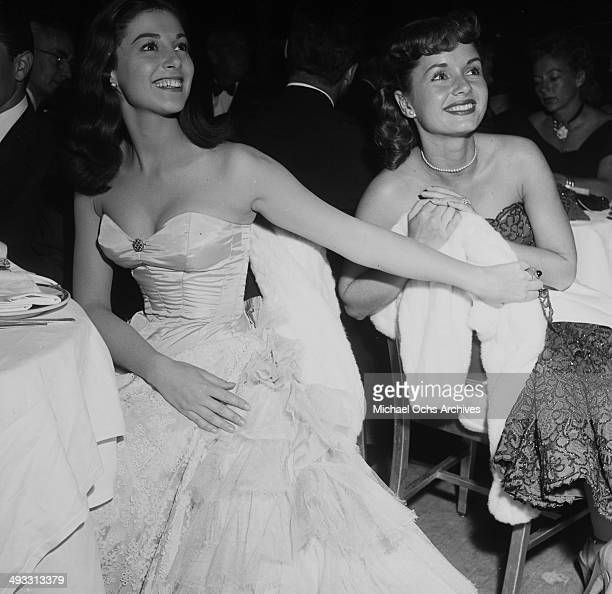 Italian actress Pier Angeli sits next to Debbie Reynolds at Cocoanut Grove to listen to Eddie Fisher in Los Angeles California