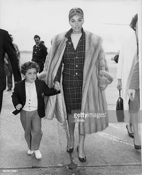 Italian actress Pier Angeli with her son at London Airport April 15th 1959