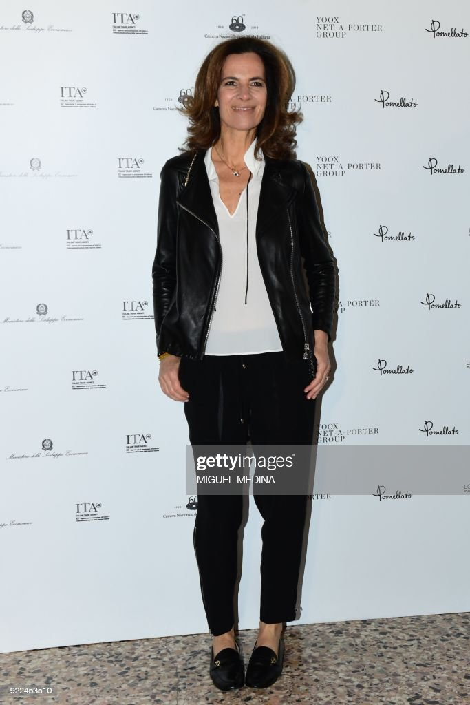 Italian actress Roberta Armani poses upon the arrival to the exhibition preview of 'Italiana, Italy Through the Lens of Fashion' at Palazzo Reale in Milan, on February 21, 2018. / AFP PHOTO / Miguel MEDINA