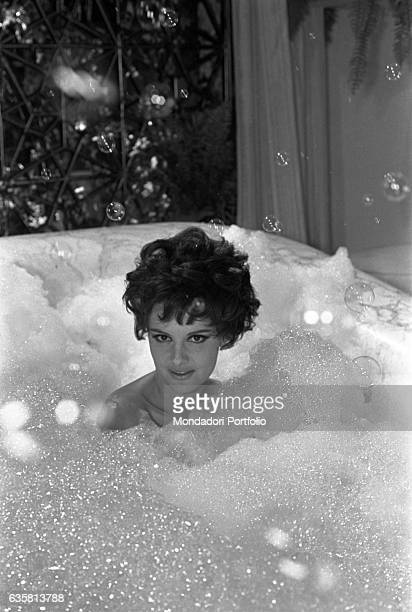 Italian actress Rossana Podestà in a bathtub filled with lather on the set of the film Seven Golden Men Strike Again 1966