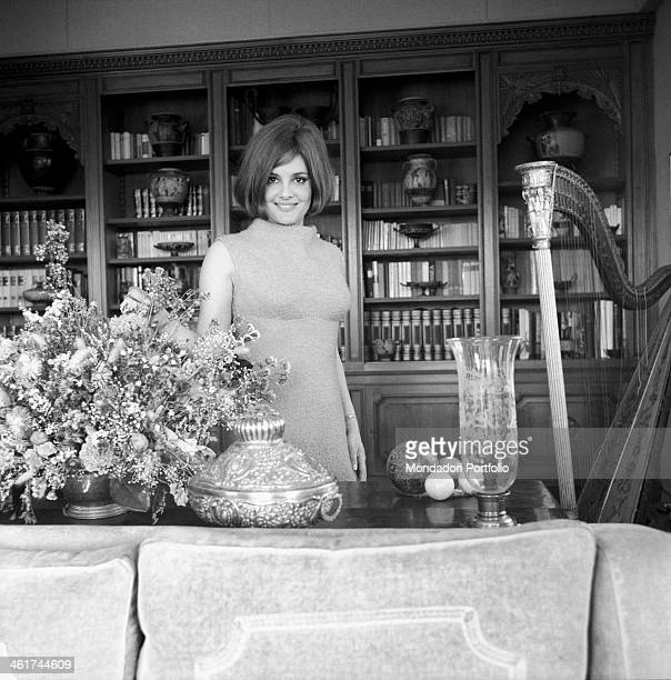 Italian actress Rossana Podestà posing smiling in her house in Rome. Rome, 1965