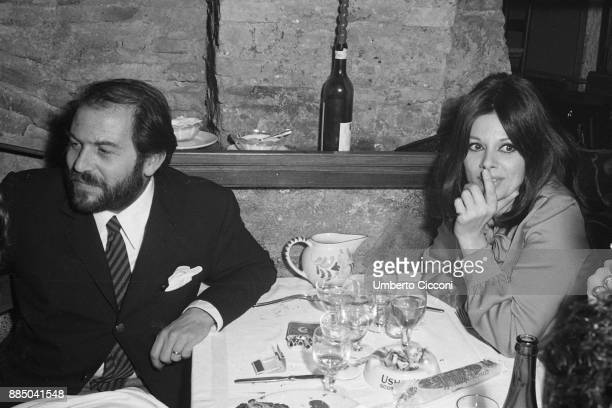 Italian actress Sandra Milo with friends at the restaurant in Via Calabria Rome 1967