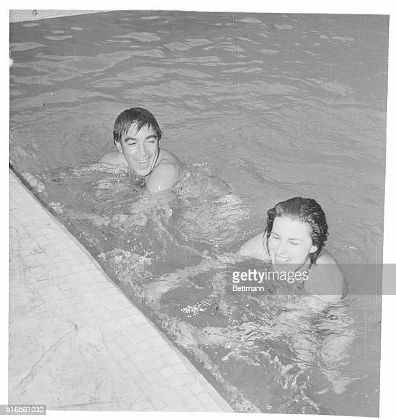 Italian actress Silvana Mangano is shown here with Hollywood movie actor Anthony Quinn as they took a swim in the Italian movie stars Rome estate...