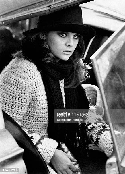 Italian actress Silvia Dionisio opening a car door in My Friends Florence 1975