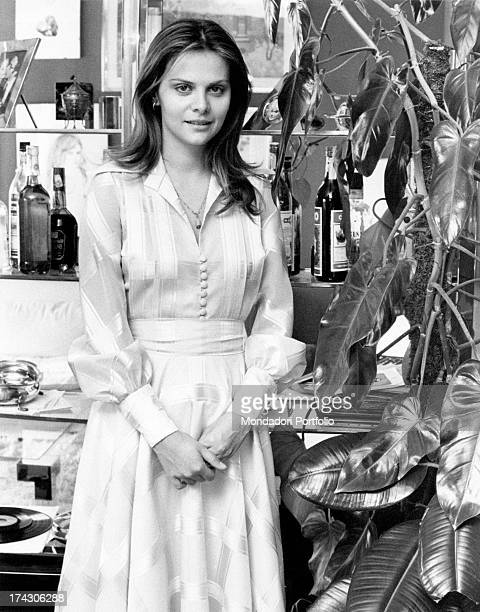 Italian actress Silvia Dionisio posing beside a plant Rome 1970s