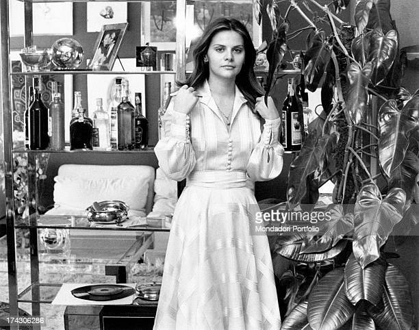 Italian actress Silvia Dionisio posing in a flat beside a plant Rome 1970s