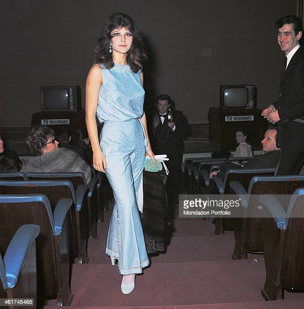 Italian actress singer and record producer Claudia Mori wearing an elegant blue dress 1960s