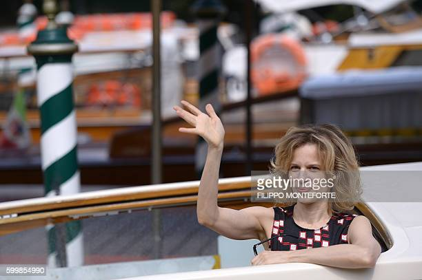 Italian actress Sonia Bergamasco waves from a taxi boat as she leaves the Hotel Excelsior during the 73rd Venice Film Festival on September 7, 2016...