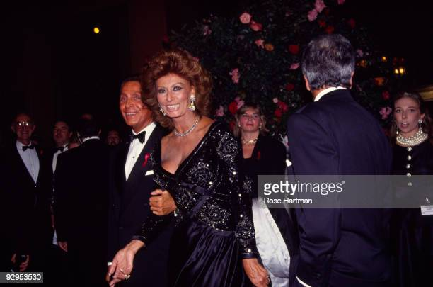 Italian actress Sophia Loren accompanied by the fashion designer Valentino attends the '30 Years of Valentino' gala held at the 67th Street Armory...