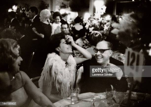 Italian actress Sophia Loren and her husband producer Carlo Ponti share a laugh at the Academy Awards dinner Los Angeles California April 1962