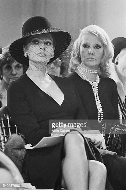 Italian actress Sophia Loren and her mother at the Christian Dior fur fashion show