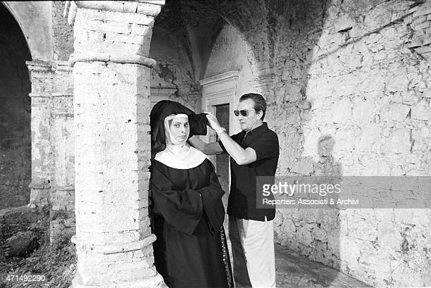 'Italian actress Sophia Loren and Italian director Luchino Visconti during a screen test for a film never shooted about the The Nun of Monza Italy...
