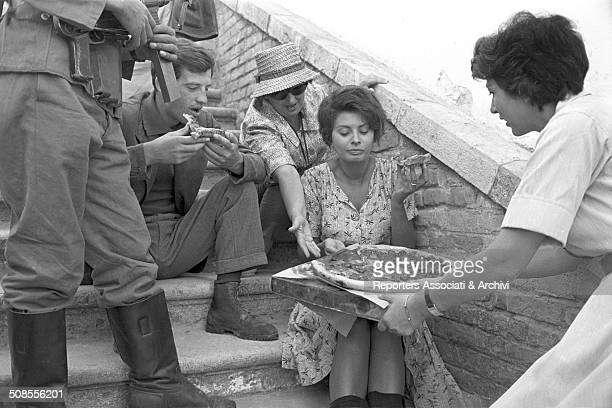 Italian actress Sophia Loren and the French actor JeanPaul Belmondo having pizza during a break on the set of the film 'The Two Women' 1960