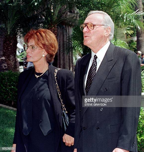Italian actress Sophia Loren arrives with an unidentified companion for the funeral of legendary entertainer Frank Sinatra at the Good Shepard...