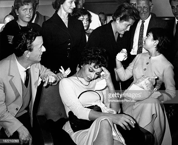 Italian actress Sophia Loren attending a party in her honour Her sister Maria Scicolone and Italian fashion designer Emilio Schuberth are among...