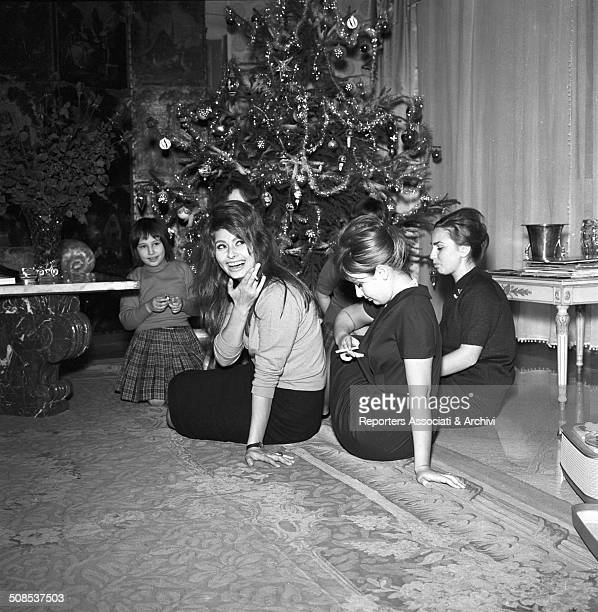 Italian actress Sophia Loren celebrates Christmas in her house of Rome with her sister Maria Scicolone and other relatives Rome 1950s